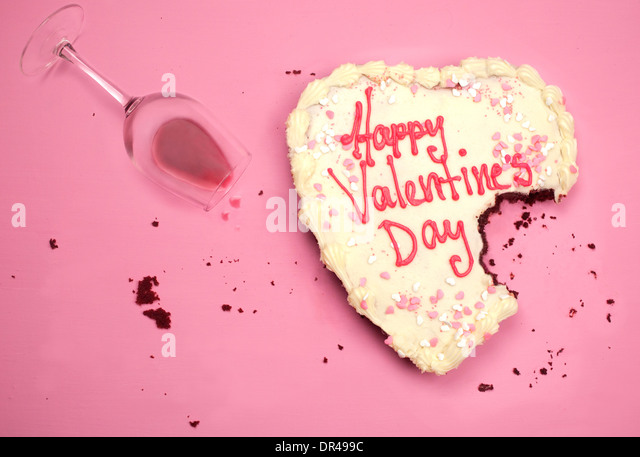 Valentine's day cake with bite taken out of it - Stock Image