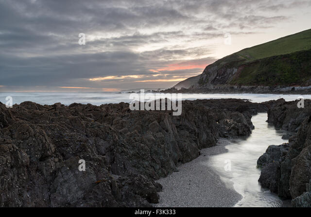 A stormy night on the beach at Portwrinkle of the south coast of Cornwall - Stock Image