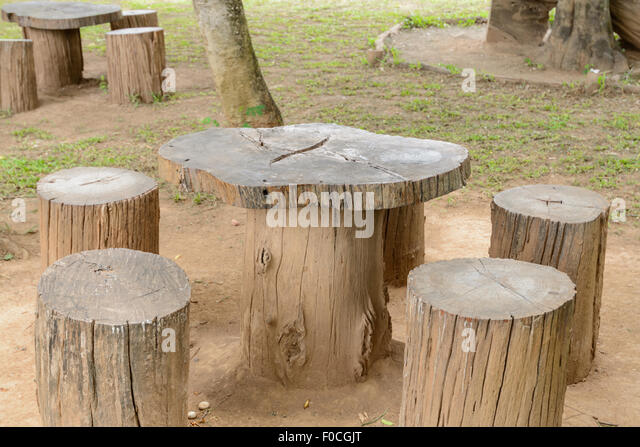 Tree stump chair stock photos tree stump chair stock - Tree trunk table and chairs ...