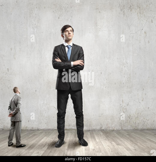 Two businessman of different size. Leadership concept - Stock Image