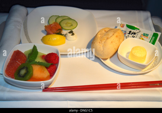 China Beijing Air China airlines onboard meal food tray fruit salad roll butter smoked salmon chopsticks service - Stock Image