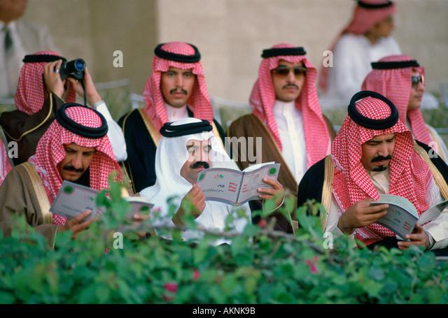 Men watching horse racing at Riyadh Races Saudi Arabia - Stock Image