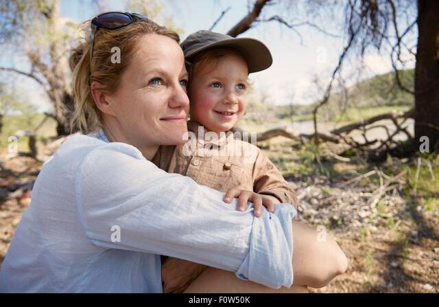 Mother and son looking at view, Ruacana, Owamboland, Namibia - Stock Image