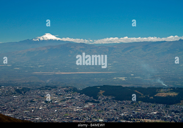 View of Cayambe volcano, Quito, and site of new Quito airport, from summit of Pichincha volcano, Quito, Ecuador. - Stock Image