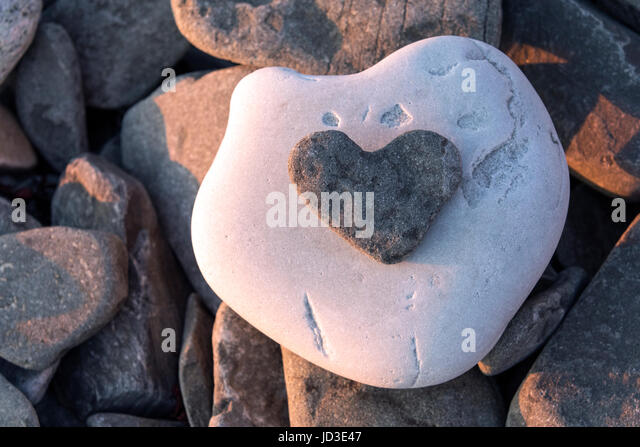 Heart-shaped Rock on Beach in Gros Morne National Park, near Rocky Harbour, Newfoundland, Canada - Stock Image