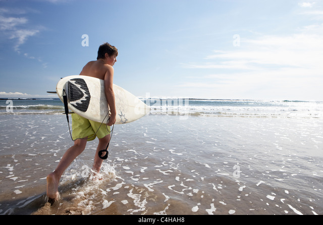 Boys surfing - Stock Image