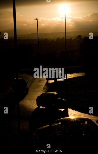 Abstract view of busy road with lampost and Dartmoor. rain, reflection, road, roadway, stone, street, structure, - Stock-Bilder