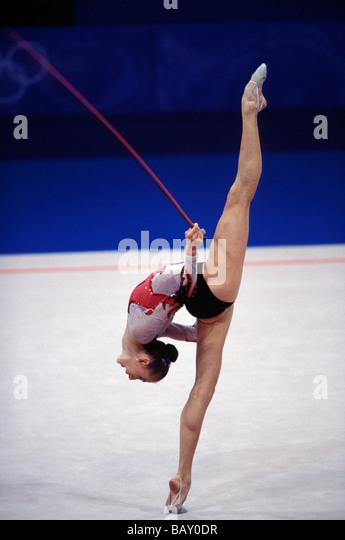 Female athlete doing rhythmic gymnastics, Sydney, Australia - Stock Image