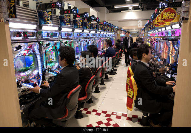 Japanese people playing pachinko, lottery, arcade game, video games, gambling, slot machines in Asian casino. Tokyo, - Stock Image