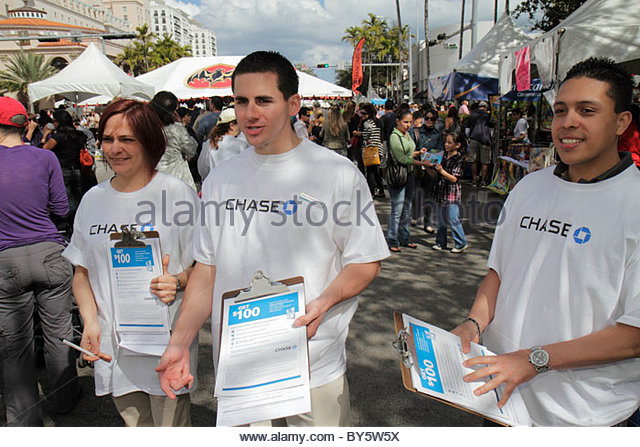 Miami Coral Gables Miami Florida Carnaval on the Mile Hispanic festival survey man woman survey opinion questionnaire - Stock Image