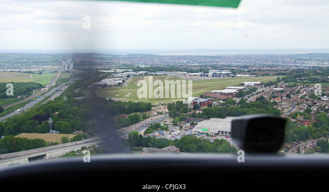 The view from the cockpit of a Cessna 170 light aircraft as coming into land at Rochester Airport in Kent - Stock Image