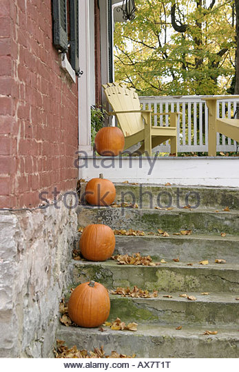 West Virginia Lewisburg historic brick home steps pumpkins fall autumn - Stock Image