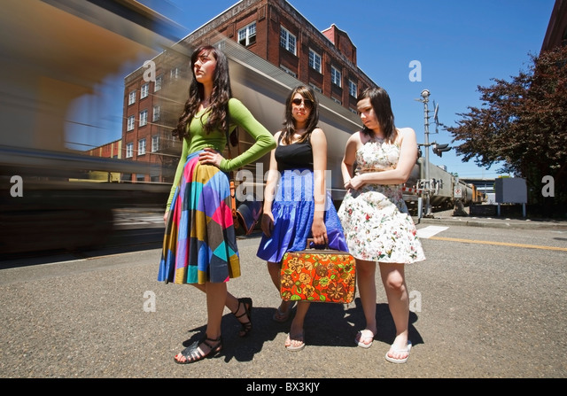 Teenage Girls Waiting For A Train In Downtown; Portland, Oregon, United States Of America - Stock Image