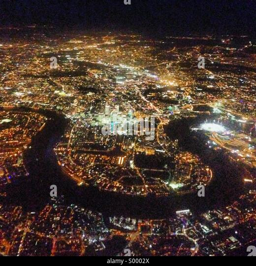 The Thames river and Central London from the air at night - Stock Image