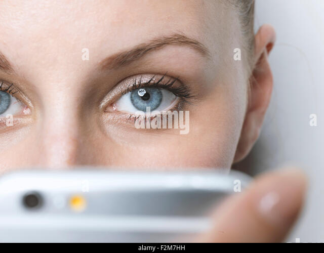 Close-up of woman with cell phone - Stock-Bilder