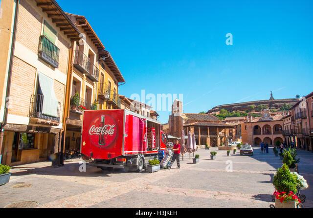 Truck delivering Coca Cola drinks at the Main Square. Ayllon, Segovia province, Castilla Leon, Spain. - Stock Image