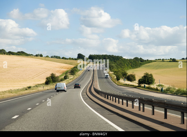Cars on a dual carriageway road in Britain - Stock Image