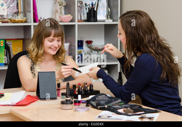 Beauty Consultants offers cosmetics client in the office - Stock Image