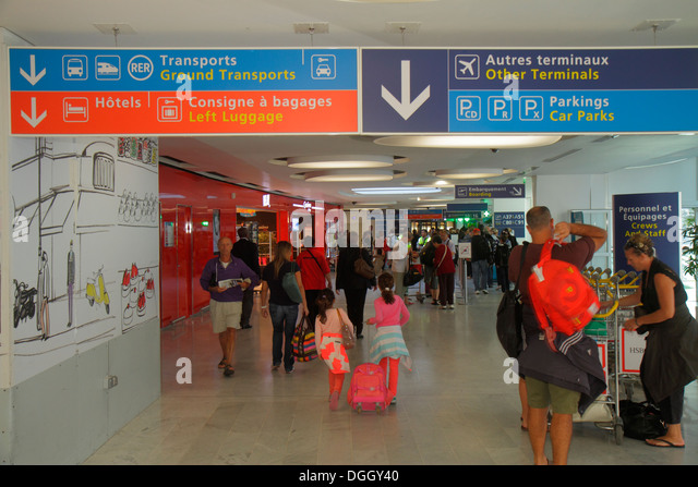 Paris France Europe French CDG Charles de Gaulle Airport terminal concourse gate area sign information directions - Stock Image