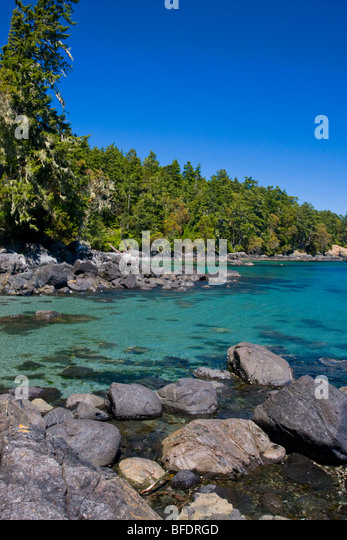 The view along the coast of East Sooke Park in Sooke, Vancouver Island, British Columbia, Canada - Stock Image