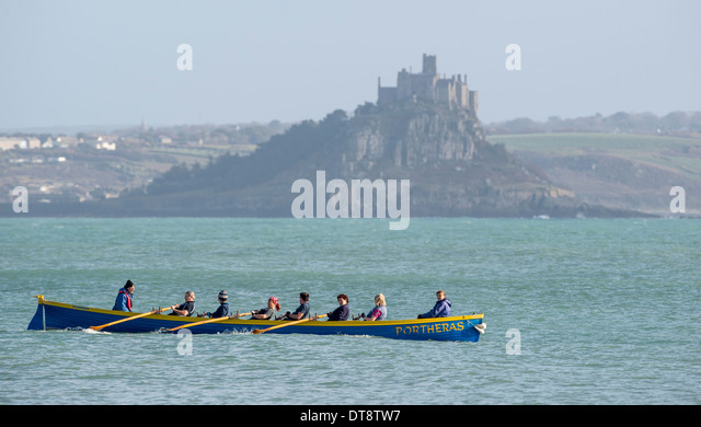 Portheras gig boat out rowing in the calm sea's of Mounts Bay near St Michael's Mount - Stock Image