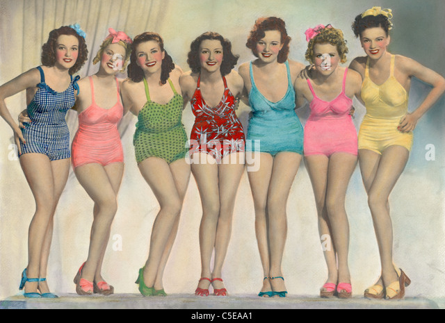 Women posing in bathing suits - Stock Image