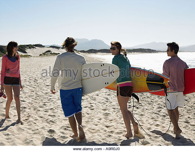 Friends going surfing - Stock Image
