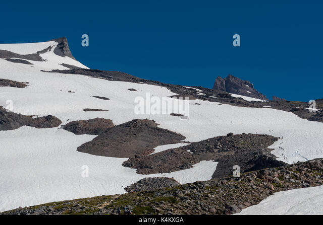 Mountaineers Cross Snow Field on Mount Rainier on way to Camp Muir - Stock Image