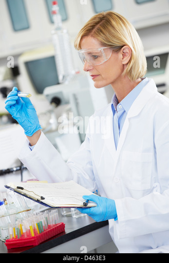 Female Scientist Working In Laboratory - Stock Image