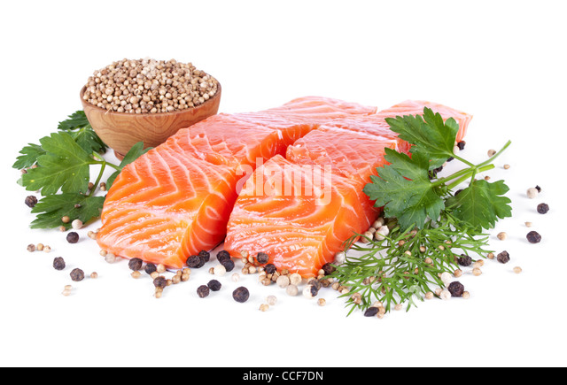 two slices trout fillet whith spices isolated on white background - Stock Image
