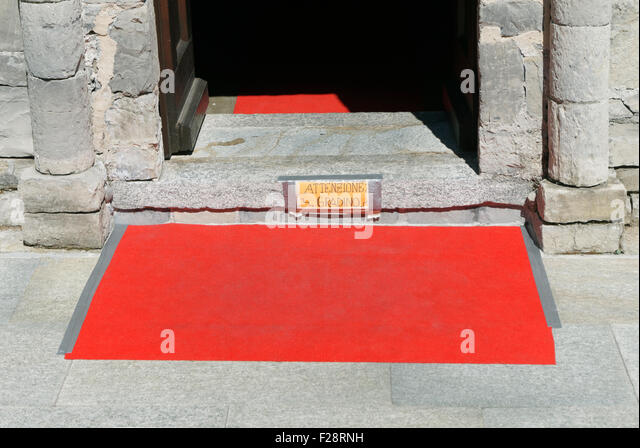 red carpet on the doorstep of a church, Italy - Stock Image