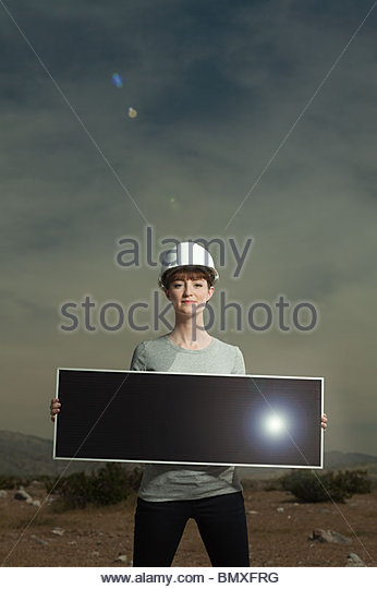 Woman holding solar panel - Stock Image