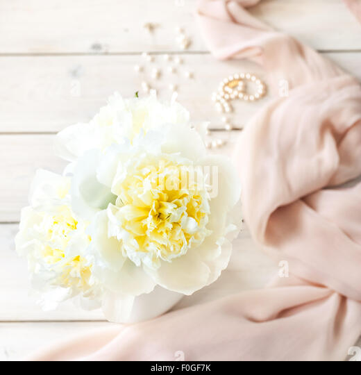 white peonies, silk and pearls - Stock Image