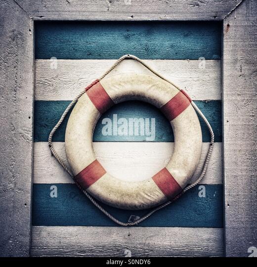 Nautical lifebouy on wooden background - Stock Image