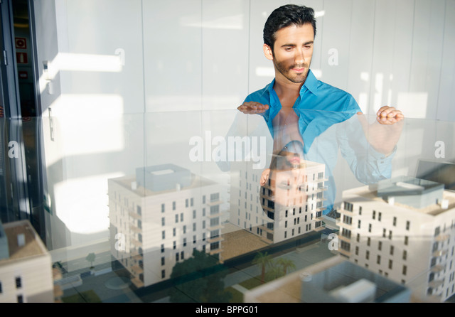 Man looking at architectural model - Stock Image