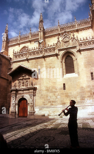 A musician plays the clarinet in front of the Cathedral in Granada, Andalucia, Spain, April 2005. Photo/Chico Sanchez - Stock Image