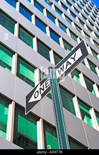 Low angle view of One Way sign - Stock Image