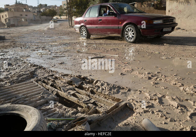 Sewage overflows in the streets of Zarqa, Jordan as a result of an overstressed wastewater treatment network. - Stock Image