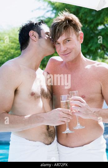 Gay couple drinking champagne - Stock-Bilder