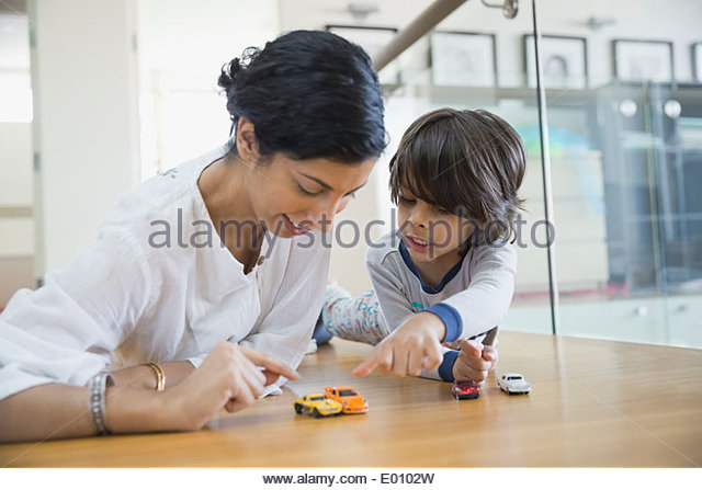Mother and son playing with toy cars - Stock Image