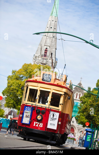 City tram with Christ Church Cathedral in the background. Christchurch, Canterbury, South Island, New Zealand - Stock Image
