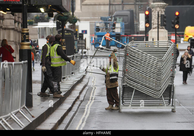 London, UK. 1st January 2017. Workmen seen assembling barricades at Whitehall ahead of the annual New Years Parade - Stock Image