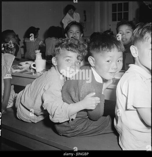 Children socialize during lunch at the Raphael Weill Public School in San Francisco, California, before people of - Stock Image