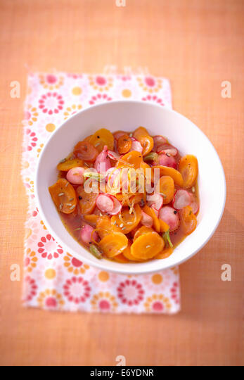 Sweet and salty carrot and radishes in grape fruit syrup salad - Stock Image