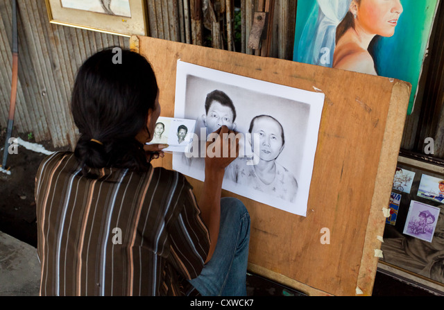 Portrait Artist in the Streets of Jakarta, Indonesia - Stock Image