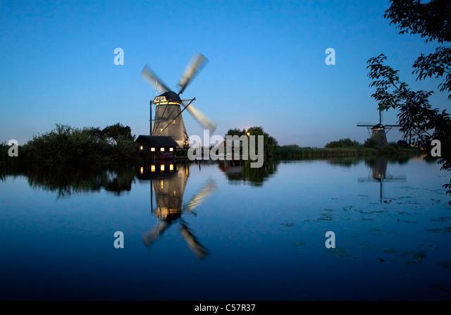 The Netherlands, Kinderdijk, Illuminated windmill, Unesco World Heritage Site. - Stock Image