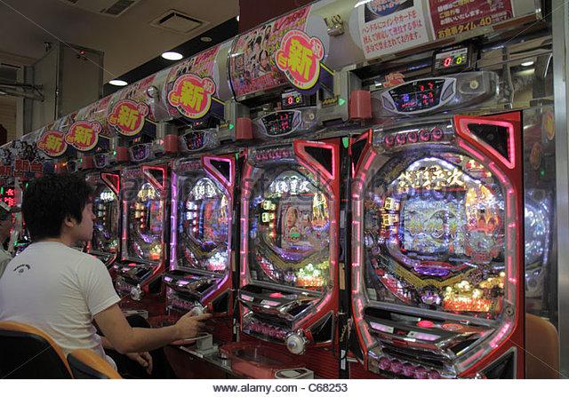 Japan Tokyo Ryogoku kanji hiragana katakana characters symbols pachinko parlor gambling prizes vertical pinball - Stock Image