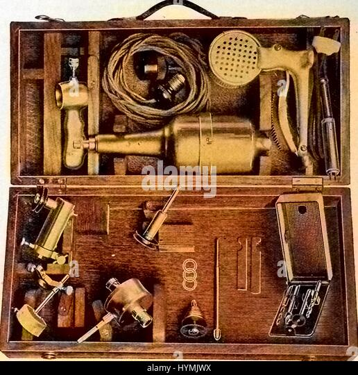 Illustration of electrical surgical instruments, including a motor driven bone saw with a foot rheostat, as well - Stock Image