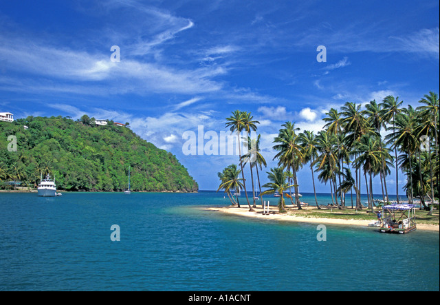 Caribbean St Lucia beach fishing boat Marigot Bay beach - Stock Image