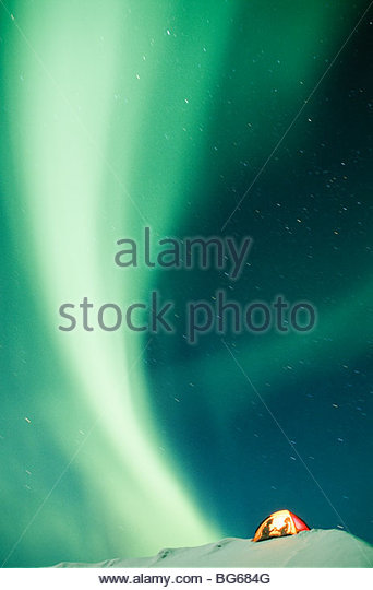 Canada. Yukon Territory. Romantic winter camping with Aurora Borealis. - Stock Image